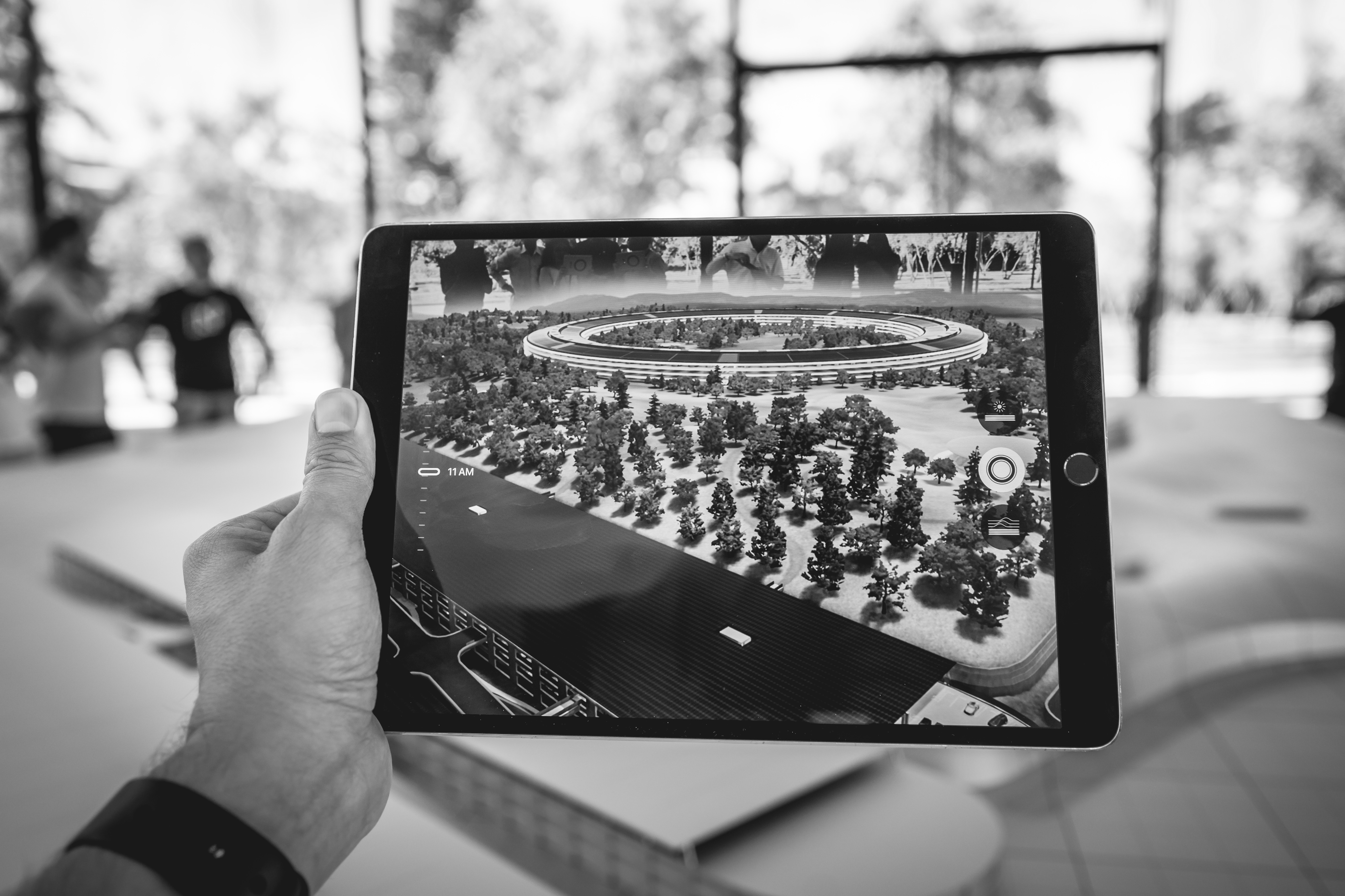 Person using Augmented Reality AR, holding tablet