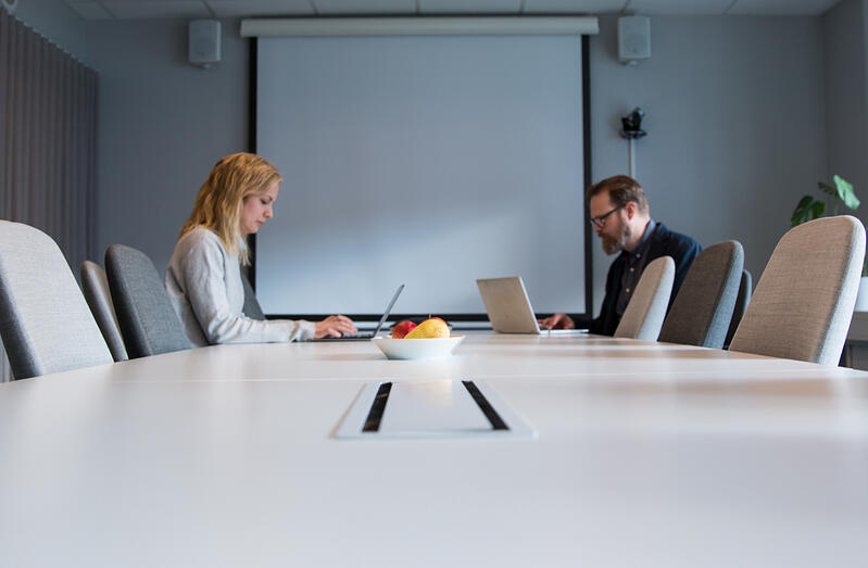 Zooma-Two-colleagues-in-a-meeting-room